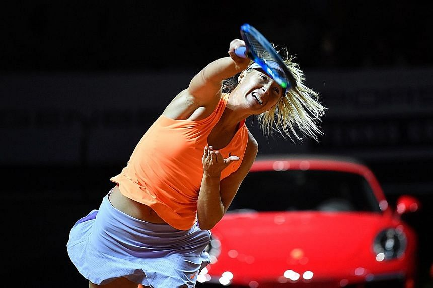 Maria Sharapova serving against Roberta Vinci of Italy in the first round of the WTA Tennis Grand Prix in Stuttgart. The former world No. 1 had 11 aces in her first competitive match since returning from a 15-month doping ban.