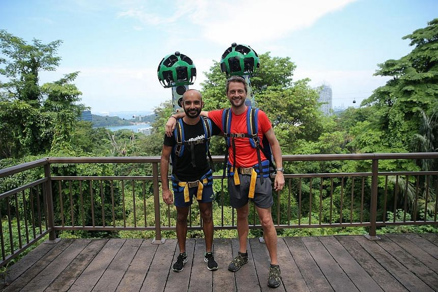 JustRunLah! members Paviter Singh Jahangir and Benjamin Flint with specialised equipment known as the Street View Trekker, which will be used to map more than 30 trail routes around Singapore.