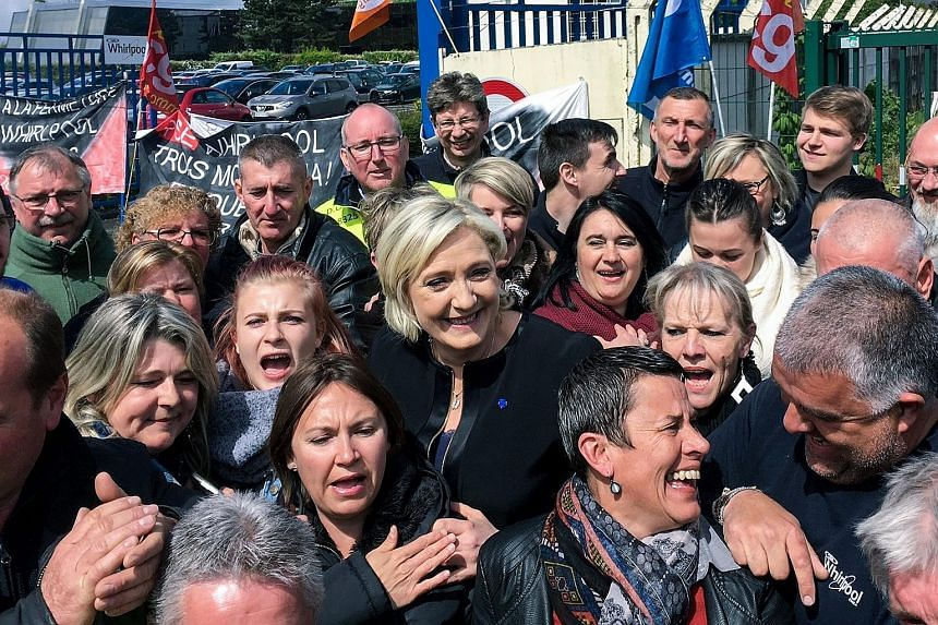 The leader of France's National Front party, Ms Marine Le Pen, getting a warm reception during her visit to the Whirpool factory in Amiens on Wednesday.