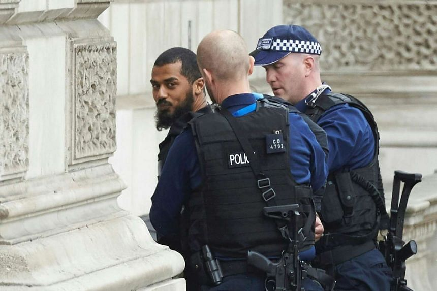 Police detain a man following an incident in Whitehall, London, April 27, 2017.