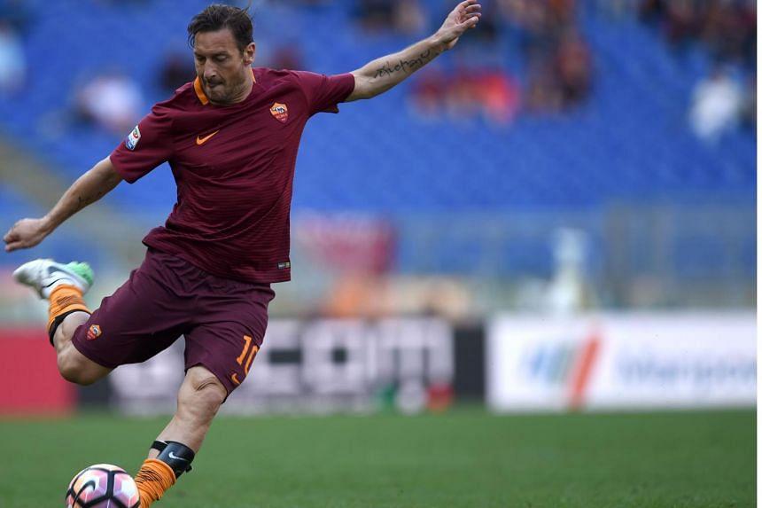 Roma's forward from Italy Francesco Totti kicks the ball during the Italian Serie A football match AS Roma vs Atalanta at the Olympic Stadium in Rome on April 15, 2017.