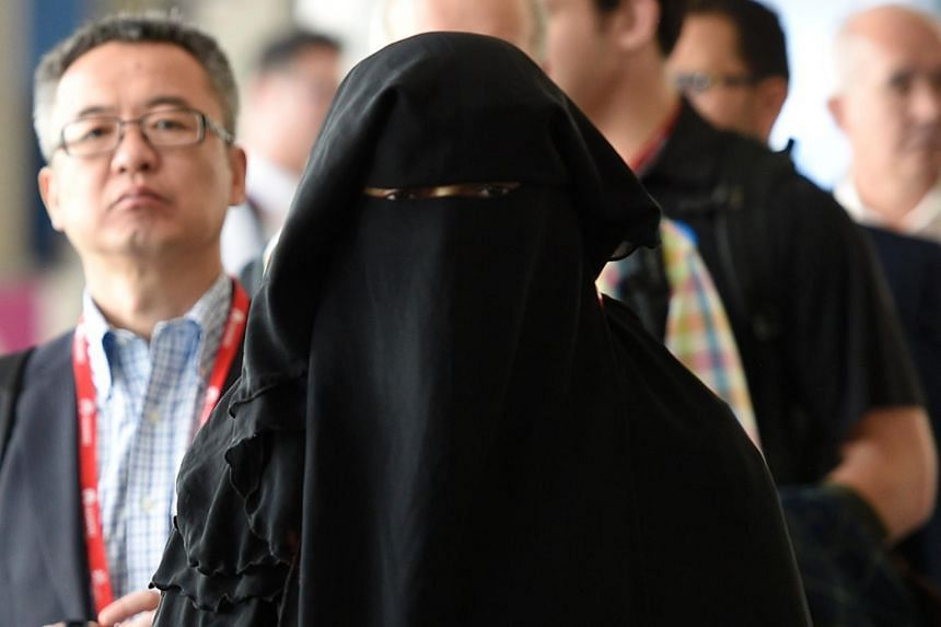 File photo of a woman dressed in a niqab.