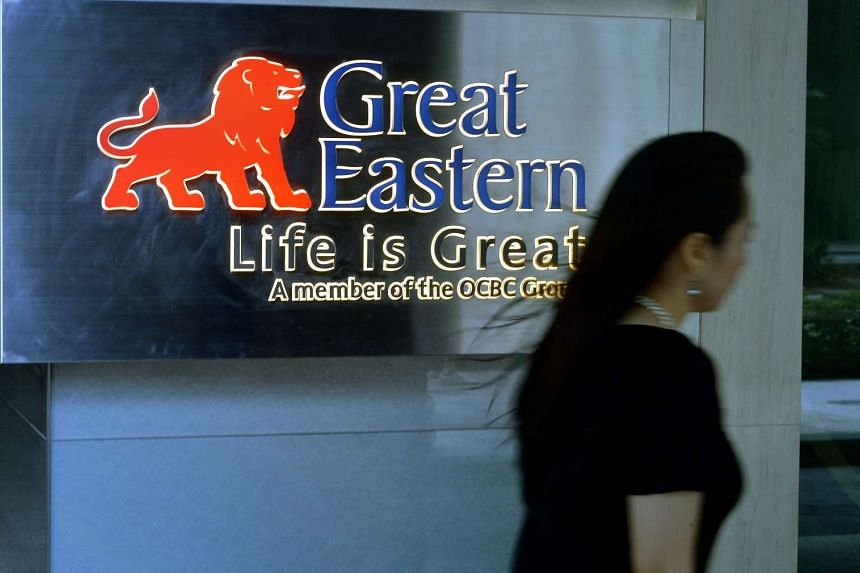 A lady walking past a Great Eastern Life signage.