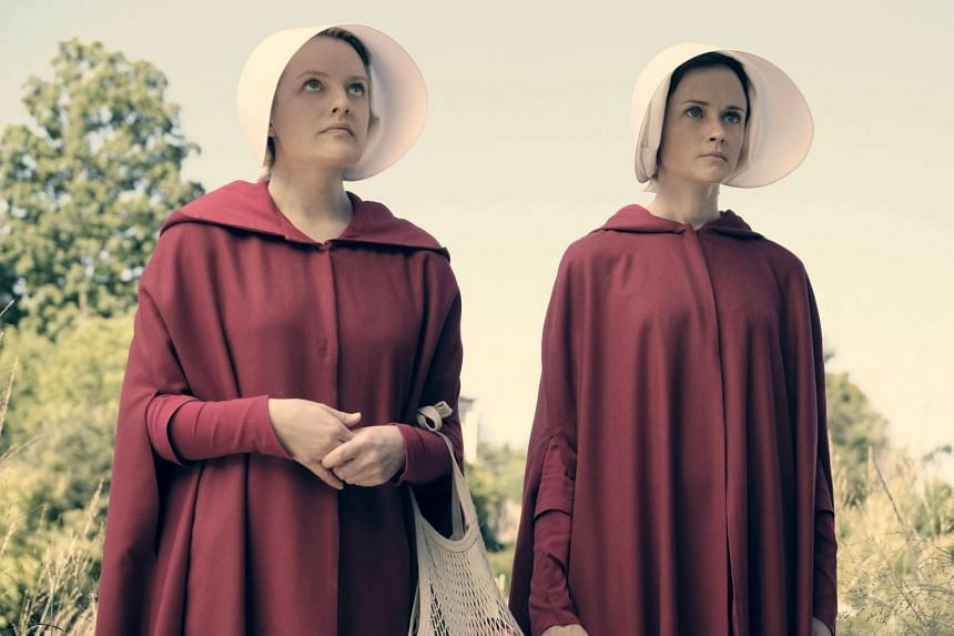 Elisabeth Moss (left) as Offred and Alexis Bledel as Ofglen in the Hulu series The Handmaid's Tale.