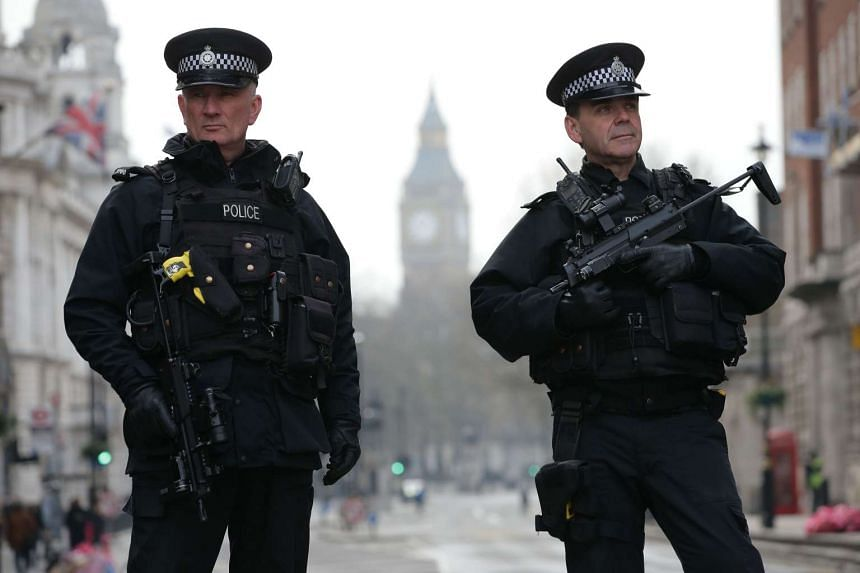 Armed police officers securing the area near the Houses of Parliament in London the day after the March 22 terror attack.