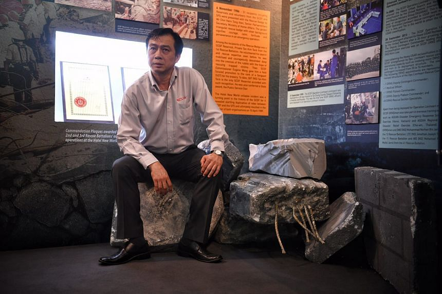 SGT (NS) Tan Kim Teck, who was involved with operations during the Hotel New World collapse, pictured in the newly opened SCDF NS Gallery.