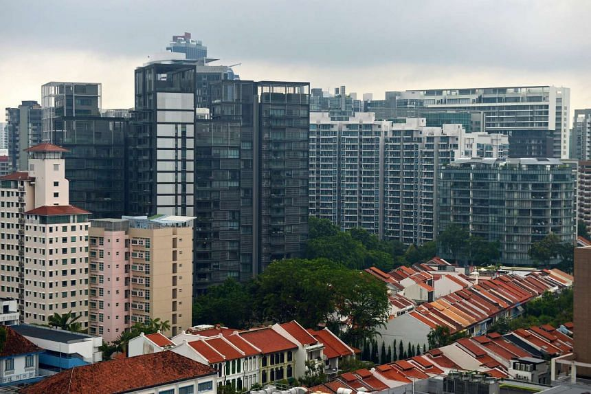 Rows of shophouses with blocks of high-rise condominium in the Orchard Road estate.