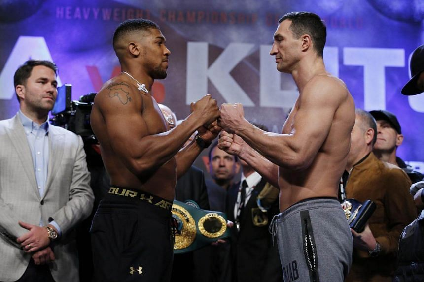 Anthony Joshua (left) and Wladimir Klitschko go head to head during the weigh-in at Wembley Arena on April 28, 2017.