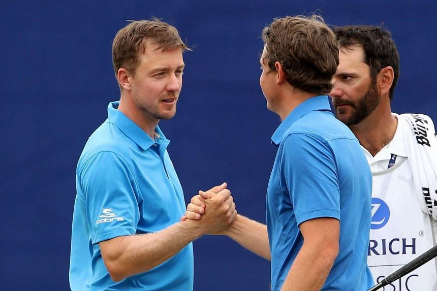 Jonas Blixt of Sweden (left) and Cameron Smith of Australia react after finishing the second round of the Zurich Classic at TPC Louisiana in Avondale, Louisiana, on April 28, 2017.