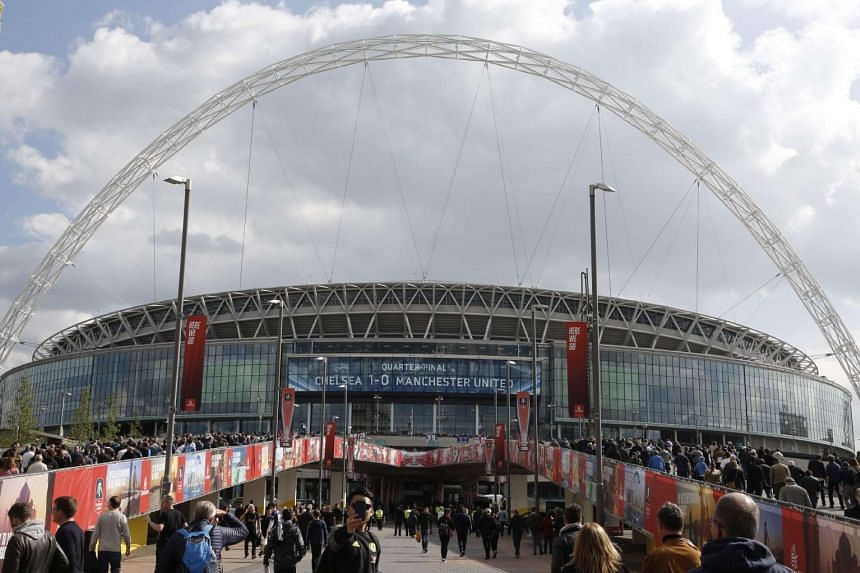 Supporters arriving at Wembley to watch Spurs play Chelsea in an FA Cup match