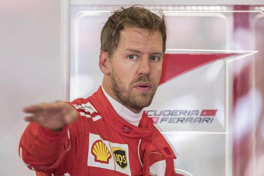 German Formula One driver Sebastian Vettel of Scuderia Ferrari in his garage during the first practice session of the Russian Formula One Grand Prix at the Sochi Autodrom circuit, in Sochi, Russia, on April 28, 2017.