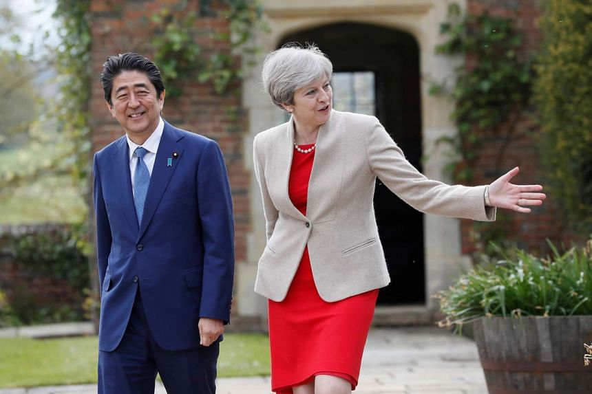 May shows Abe around the garden during a visit to Chequers.