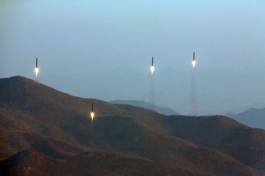 A file photo showing four projectiles during a ballistic rocket launching drill of Hwasong artillery units of the Strategic Force of the Korean People's Army.