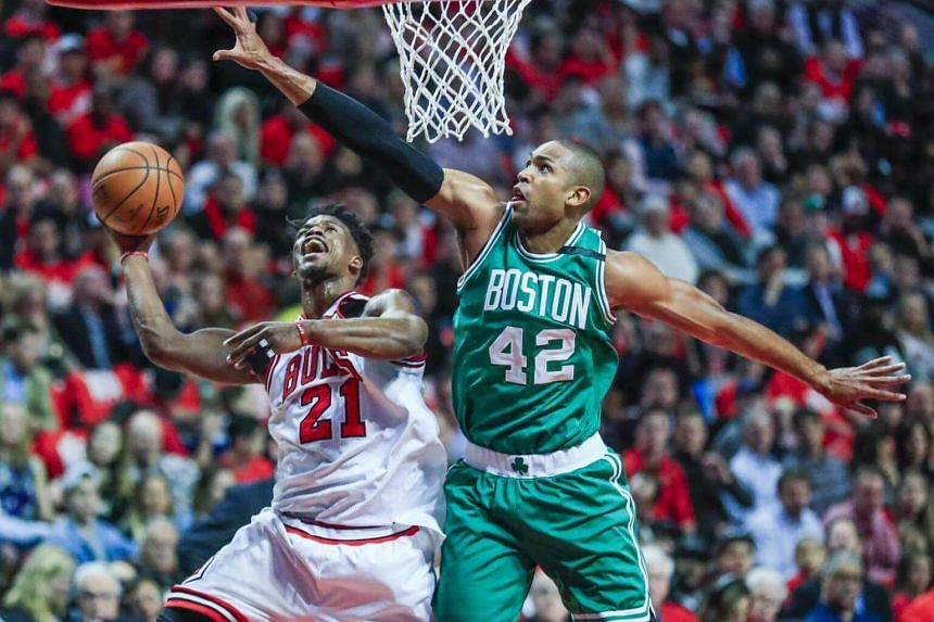 Chicago Bulls forward Jimmy Butler (left) shoots on Boston Celtics centre Al Horford in game six of the first round of the NBA Eastern Conference playoffs at the United Center in Chicago, Illinois, US, on April 28, 2017.
