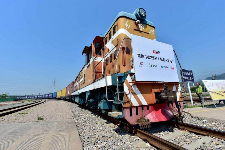 A freight train transporting containers laden with goods from London, arrives at Yiwu railway port station in Yiwu, east China's Zhejiang province on April 29, 2017.