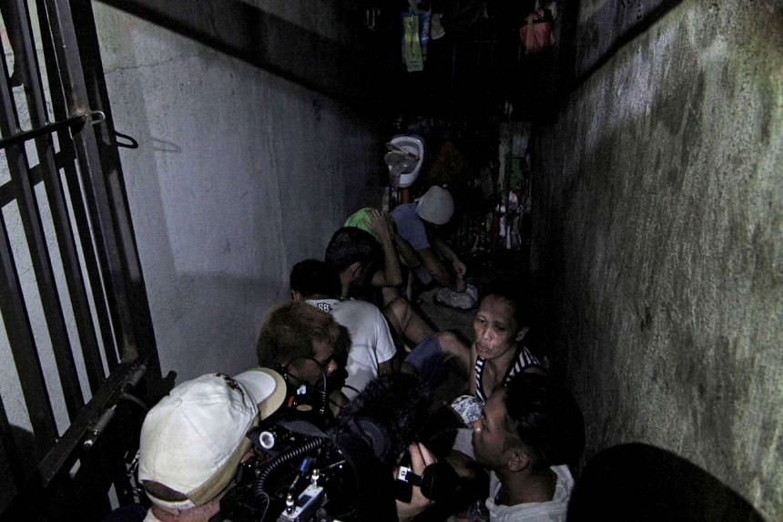 People allegedly kept inside a hidden room at the Drug Enforcement Unit of the Manila Police Department's Police Station 1 in the Tondo area of Manila.