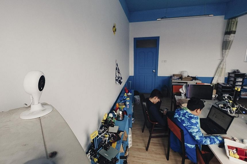 A live-streaming camera at the Deep Blue Children Robot Centre in Jimo, Shandong province. Thousands of schools in China are broadcasting their students live on public websites, crowdsourcing the task of supervision.