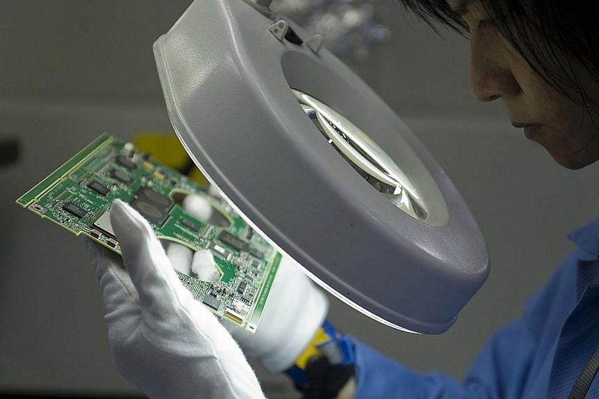 Circuit boards being inspected at a Venture Corp factory. The company said it began the year with positive momentum, and will continue to focus on investing in engineering talent and advanced manufacturing capabilities.