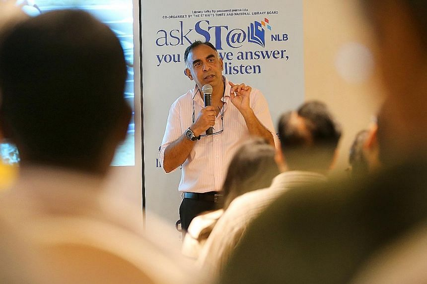 Mr Rohit Brijnath speaking at Library@Orchard yesterday in the final instalment of the year-long askST@NLB series. His talk, attended by 165 people, was peppered with stirring videos of athletes' accomplishments.