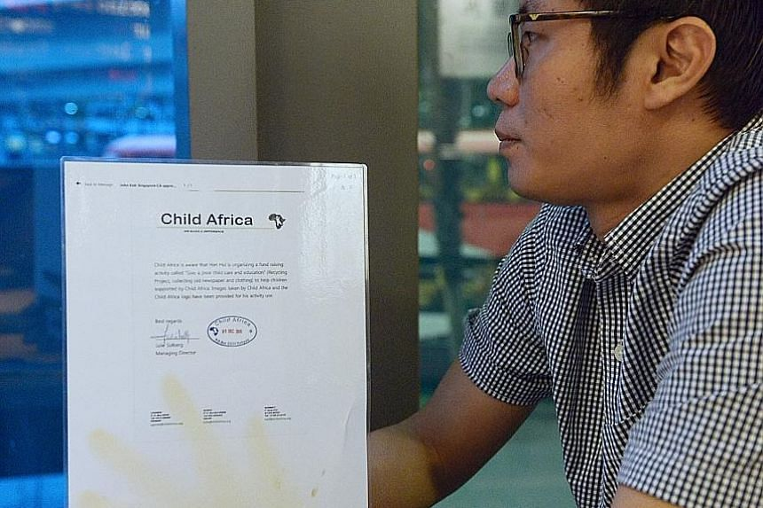(Left) Mr Dave Wong with a letter issued by a charity called Child Africa to show it is aware of his donation drive.