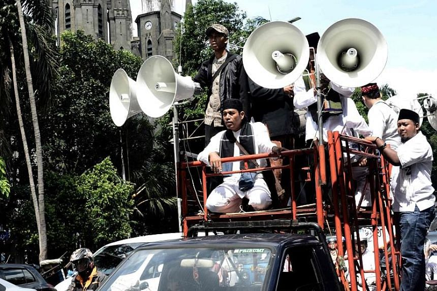 Muslim protesters taking to the streets after Friday prayers in Jakarta to demonstrate against outgoing Governor Basuki Tjahaja Purnama - also known as Ahok - who has been accused of blasphemy against Islam. A court will rule on the case on May 9.