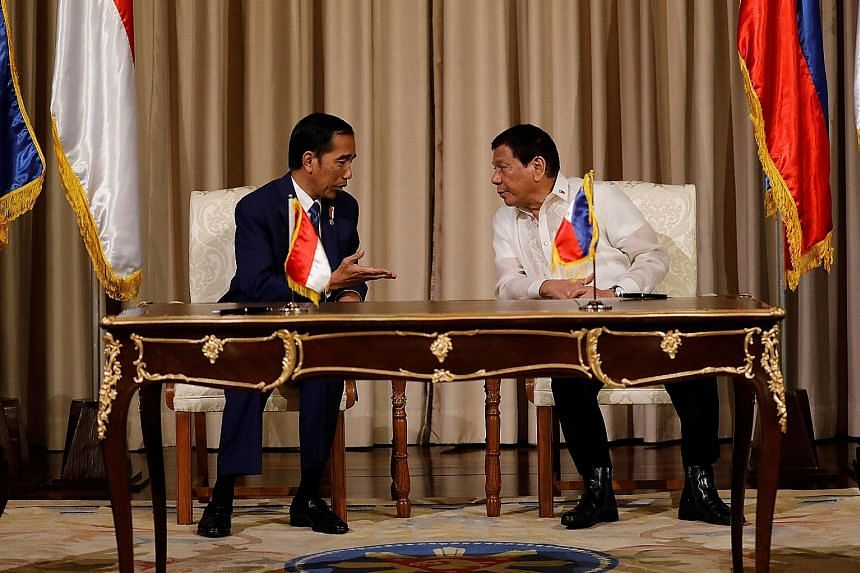Philippine President Rodrigo Duterte (right) had talks yesterday with visiting Indonesian President Joko Widodo at the presidential palace ahead of the Asean summit in Manila. The two countries agreed to step up efforts to combat terrorism, piracy an