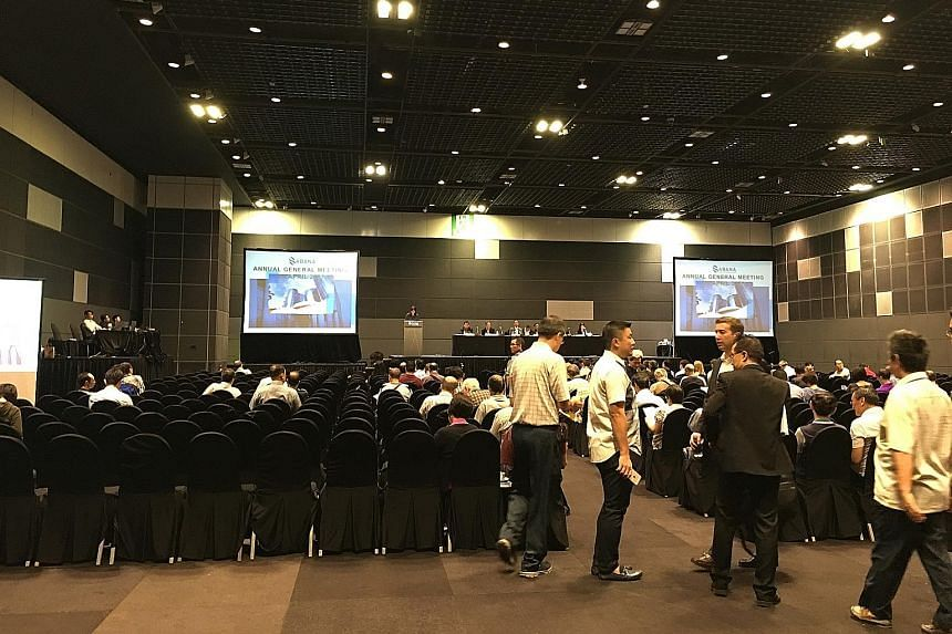 Investors at Hall 404 before the meeting started. On stage are the board members of Sabana Reit Management and a representative from the HSBC trustee.