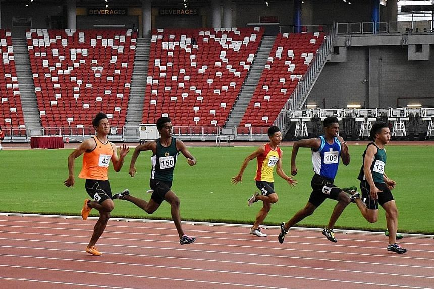Catholic Junior College's S. Shahmee Ruzain (No. 109) on the way to winning the A Boys' 100m yesterday.