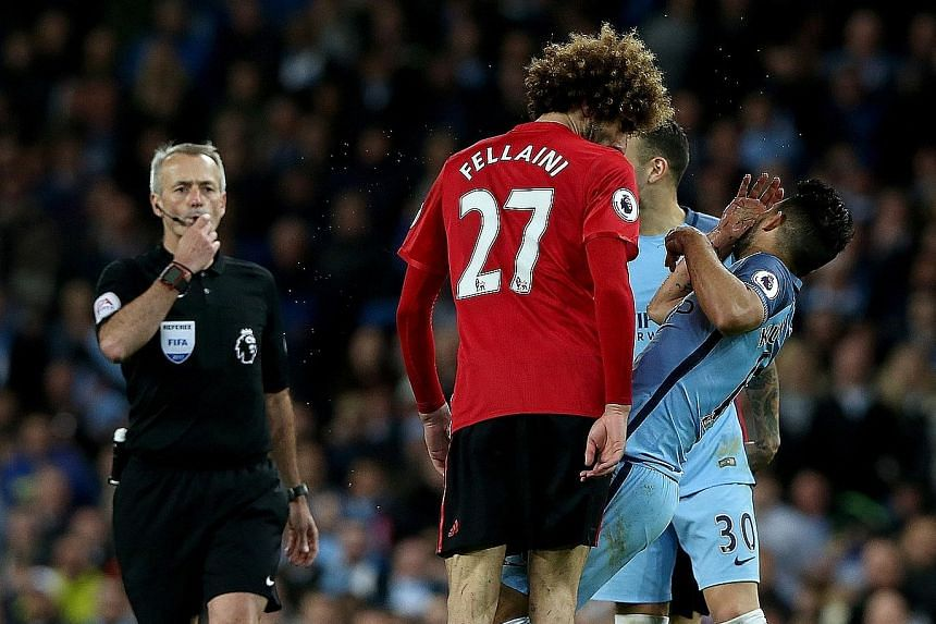 Manchester United midfielder Marouane Fellaini headbutts Manchester City striker Sergio Aguero during a Premier League match at the Etihad Stadium. Referee Martin Atkinson gave the Belgian a straight red card in the 84th minute. Just 19 seconds befor