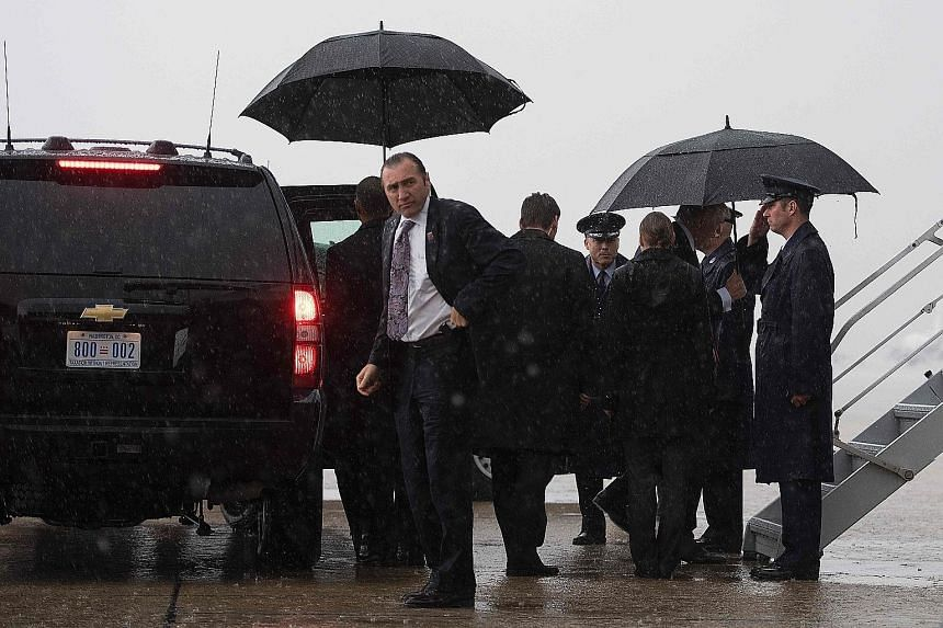Secret Service agents surrounding Mr Donald Trump at Andrews Air Force Base in Maryland this month.