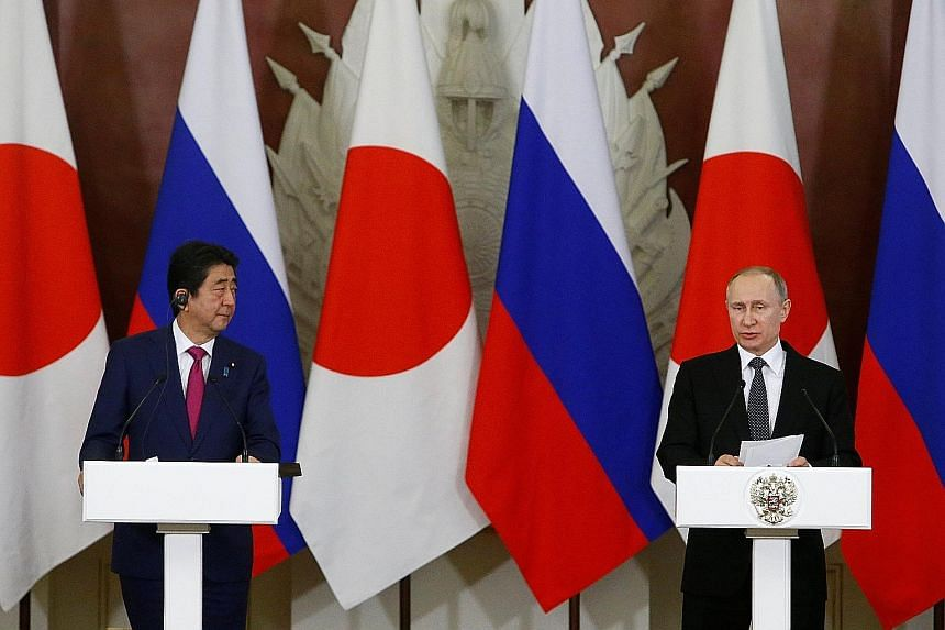 Japanese Prime Minister Shinzo Abe and Russian President Vladimir Putin at a media briefing following their meeting at the Kremlin in Moscow on Thursday. The two also spoke about rising tensions over North Korea.