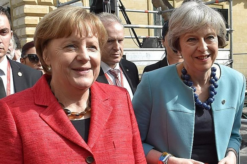 Dr Angela Merkel (left) with Mrs Theresa May at an EU summit in Malta in February. Dr Merkel said on Thursday that Brexit talks from the very start should include Britain's financial obligations.