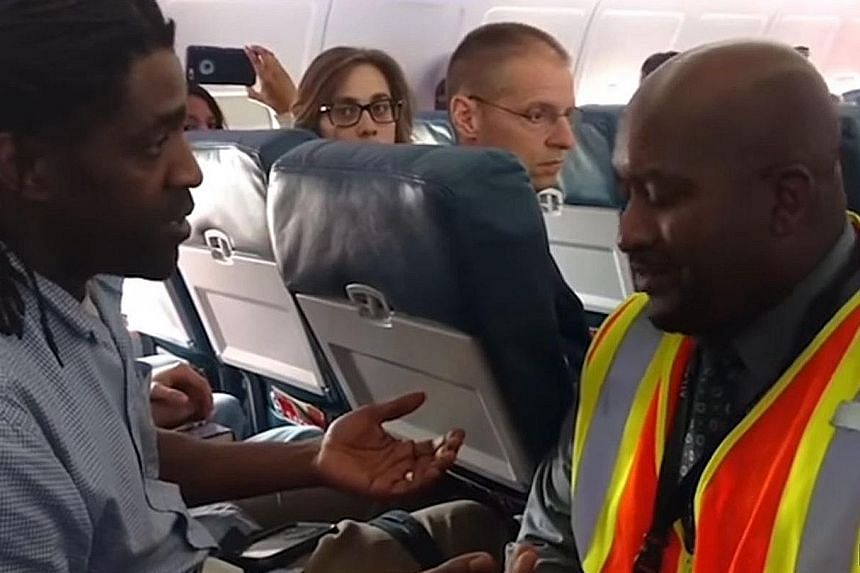 A video showing Mr Kima Hamilton talking to an agent during the April 18 incident on board a Delta Air Lines plane in the US.