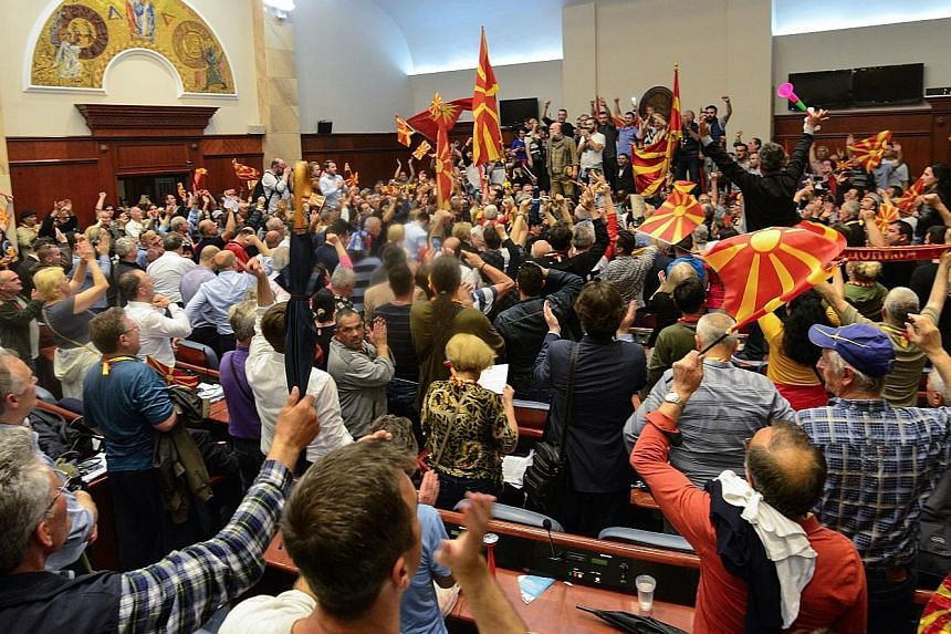 Nationalists protesting against a vote that led to Mr Talat Xhaferi's election as Macedonia's Speaker of Parliament. The country has been in a political gridlock since 2015.