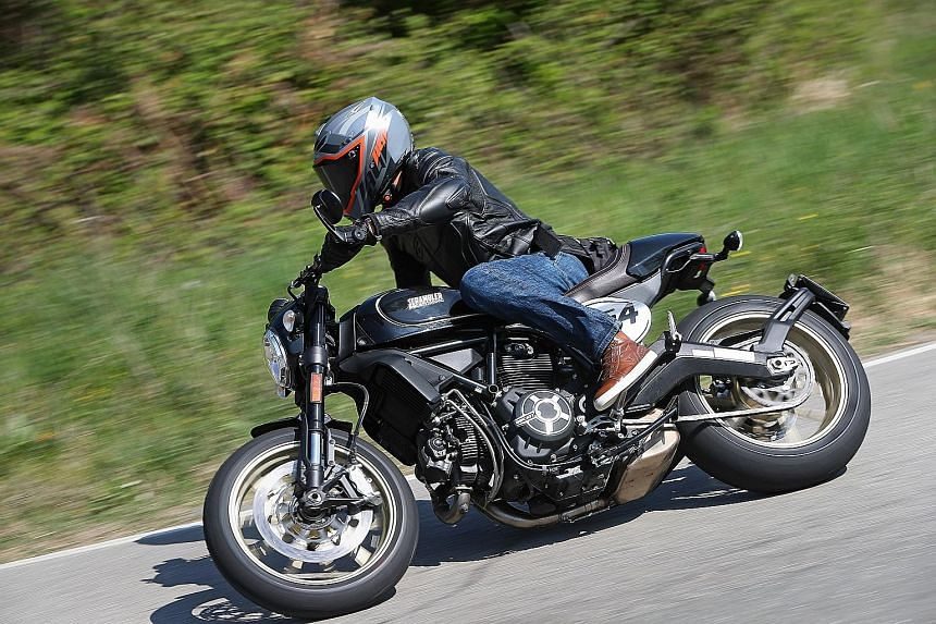The Ducati Scrambler Cafe Racer (above, with the writer on a 180km test- route in Bologna, Italy) lacks horsepower, but on tight, winding mountain roads, it is easy to handle.