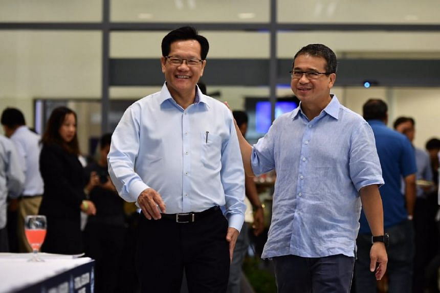 Lim Kia Tong (left) is the new president of the Football Association of Singapore (FAS).