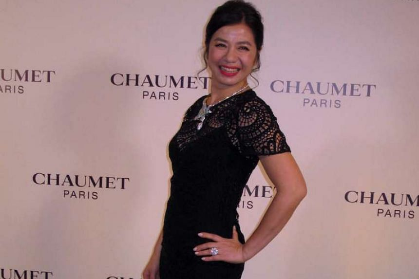 Cherie Chung at French jeweller Chaumet's event in Beijing earlier this month. The former star, whose husband died 10 years ago, says she likes being alone.