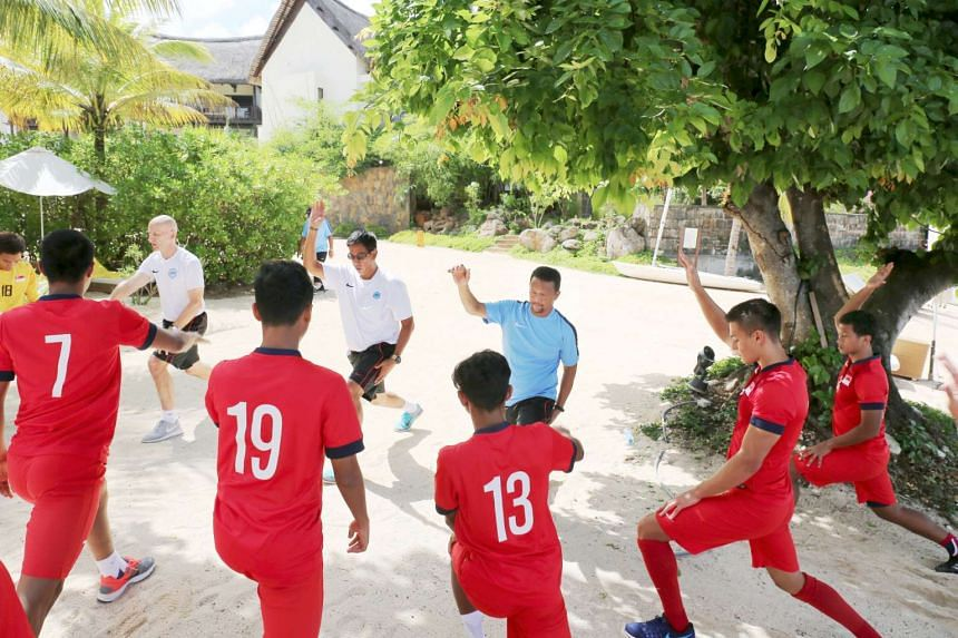 Singapore's under-20 team training with coach Fandi Ahmad (in blue) in Mauritius in March 2017.