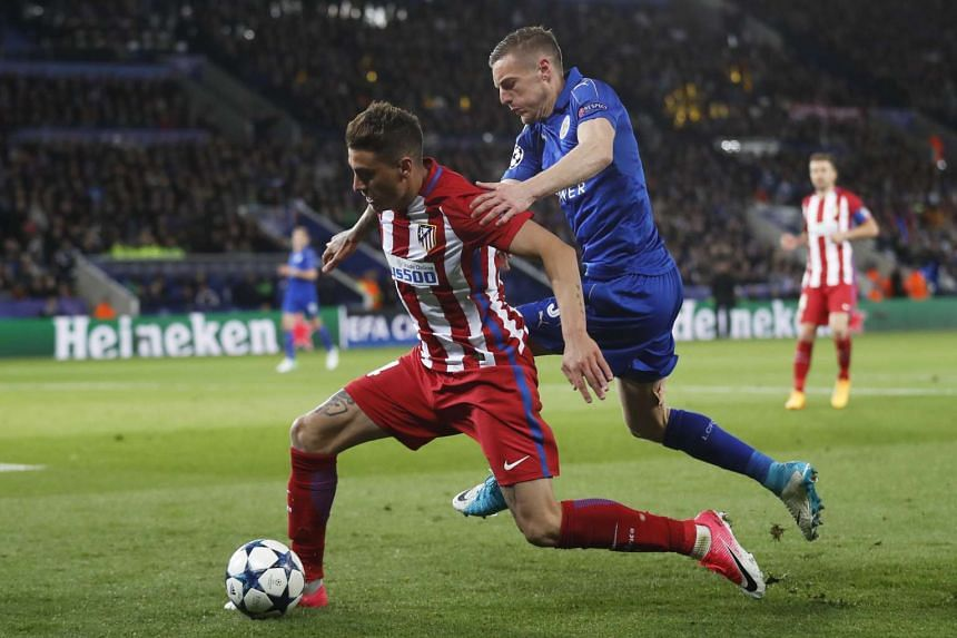 Atletico Madrid defender Jose Gimenez (left) fighting for the ball against Leicester City striker Jamie Vardy on April 18, 2017.