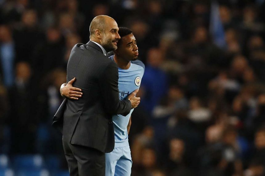 Manchester City manager Pep Guardiola and Gabriel Jesus at the end of the match against Manchester United on April 27, 2017.