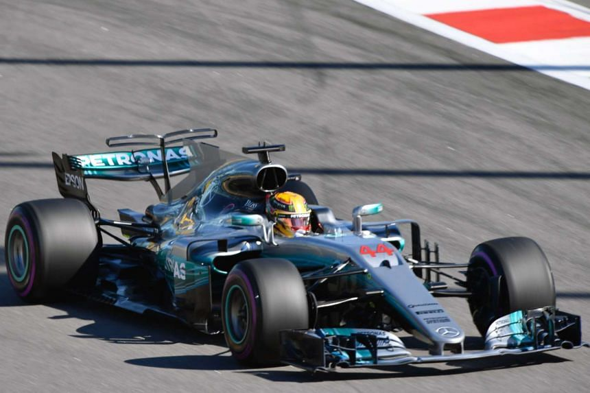 Mercedes' British driver Lewis Hamilton steers his car during the Sochi qualifying session.