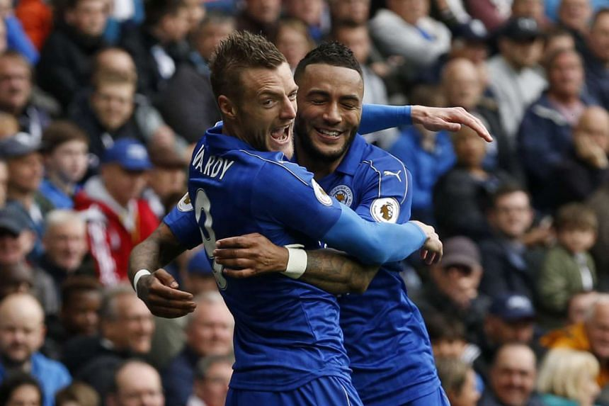 Leicester City's Jamie Vardy celebrates scoring their first goal with Danny Simpson.