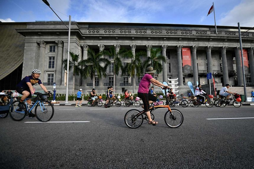 People riding on bikes in front of the National Gallery Singapore, on car-free Sunday, on April 30, 2017.