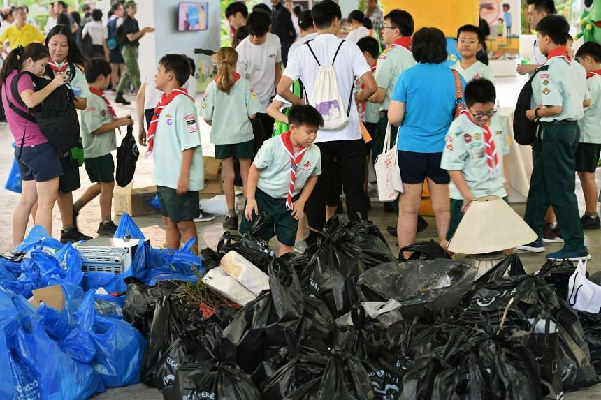 Supporters of the Keep Clean, Singapore! initiative looking at the litter that was picked up along Petir Road, on April 30, 2017.