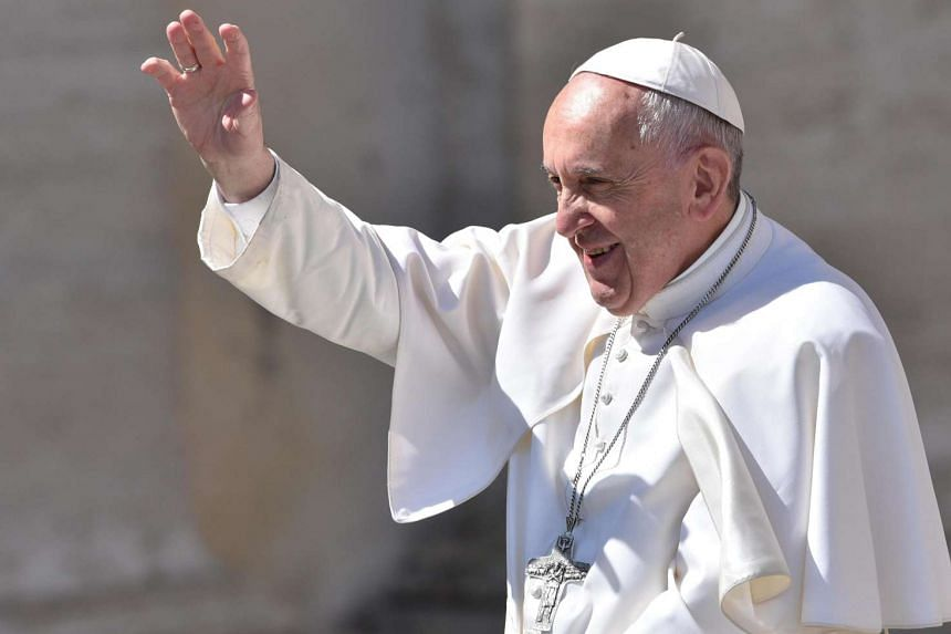 Pope Francis waving to the crowd in St Peter's Square on April 30, 2017.