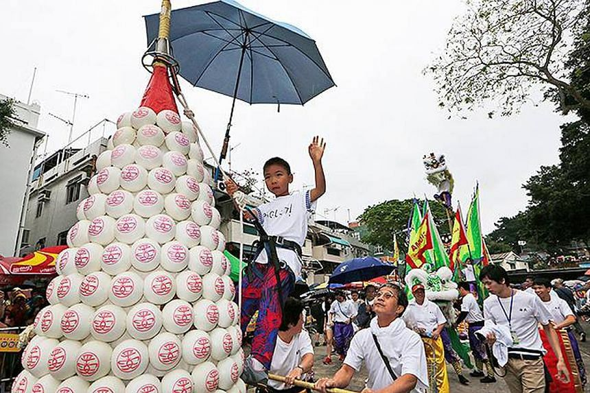 To celebrate the Cheung Chau Bun Festival in Hong Kong, the locals build 20m-tall metal towers covered in buns. Statues of Saint Marie-Jacobe and Saint Marie-Salome are carried in a procession during the annual Pilgrimage of the Gypsies in France.