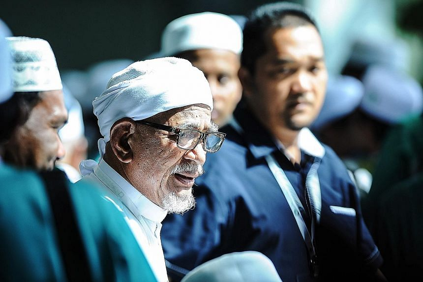 PAS president Abdul Hadi Awang at the party's annual congress yesterday, where he said the party 's nationwide reach would help it achieve its election goals. Delivering his policy speech to some 1,200 delegates, he also advocated PAS' vision of form