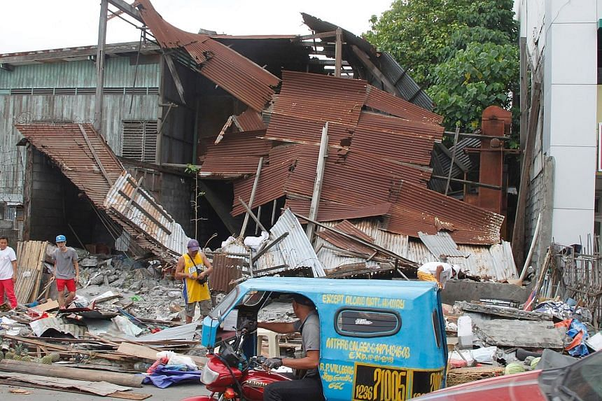 The earthquake early yesterday triggered the collapse of at least one house in General Santos city, in Mindanao, and also left cracks in a hospital, two government buildings and a port.