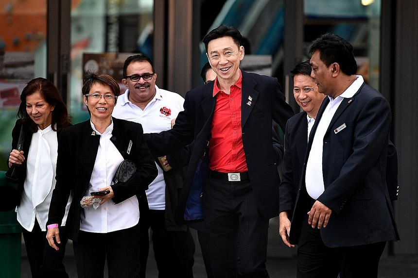 Mr Bill Ng (in red shirt) with (from left) vice-president nominees Annabel Pennefather and Teoh Chin Sim, supporters Suresh Nair and Francis Lee, and former national goalkeeper and council member nominee Shahri Rahim.
