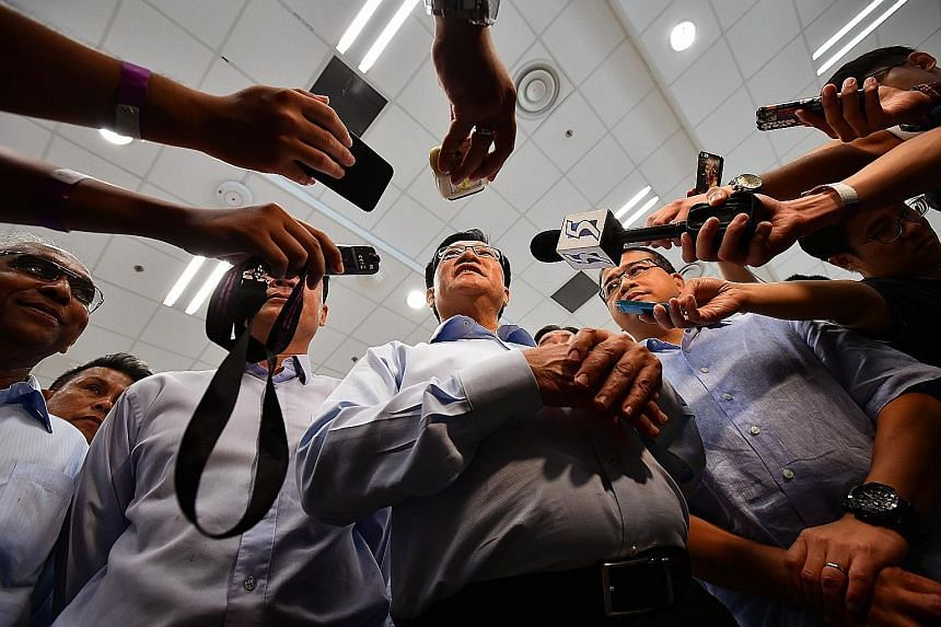 Mr Lim Kia Tong, the new FAS president, meeting reporters after the election at the Sports Hub's Black Box Auditorium yesterday.